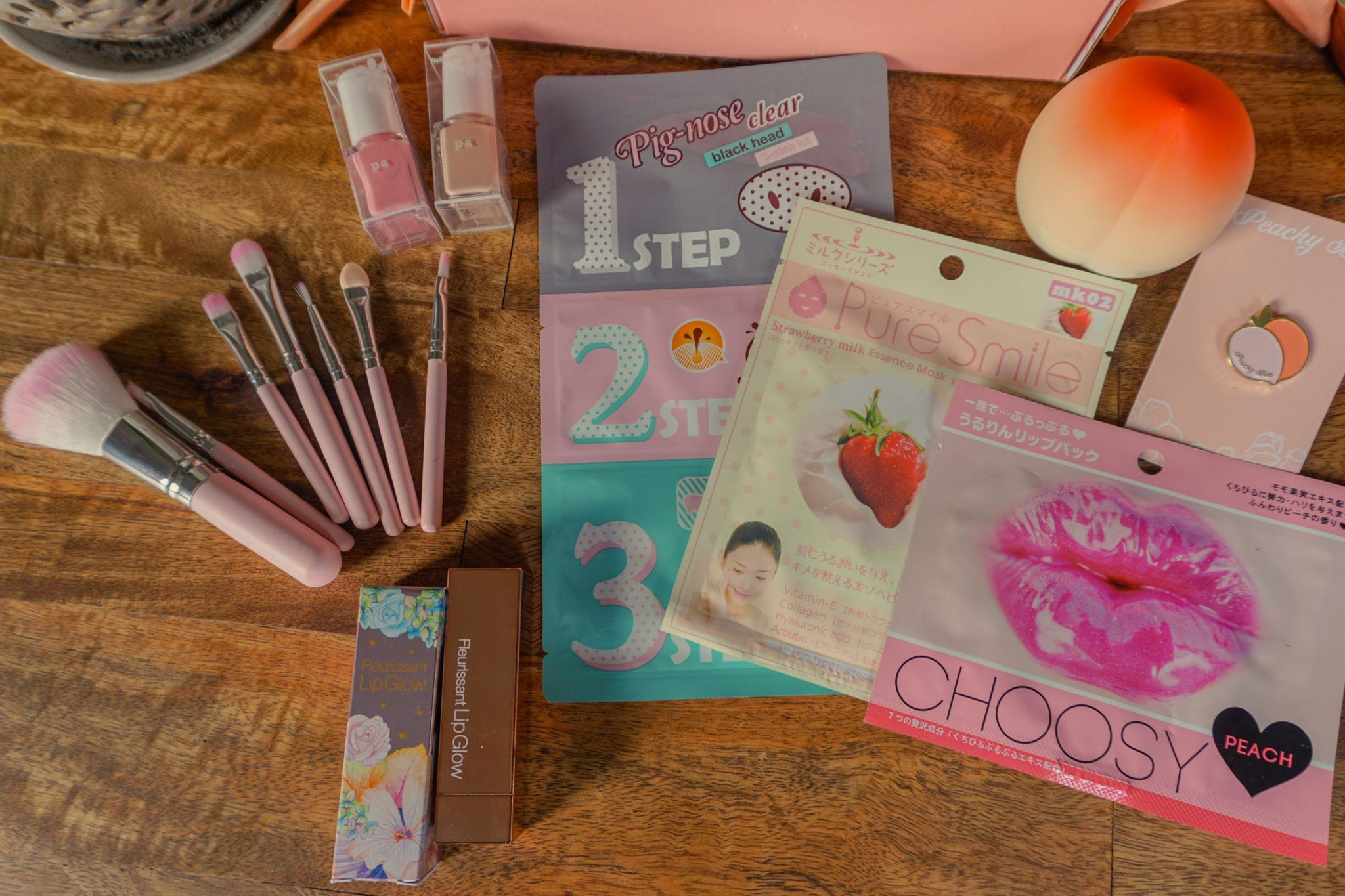 Peachy Box's madian June box filled with beauty products, accessories, stationary and more