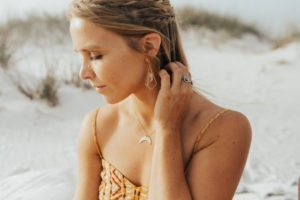 Pure Life JewelryPure Life Jewelry featuring the Geometric Crystal Earrings, Moon Phase Necklace and Radiate Love Ring