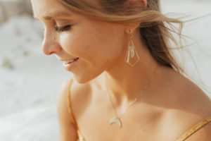 Pure Life Jewelry featuring the Geometric Crystal Earrings and Moon Phase Necklace