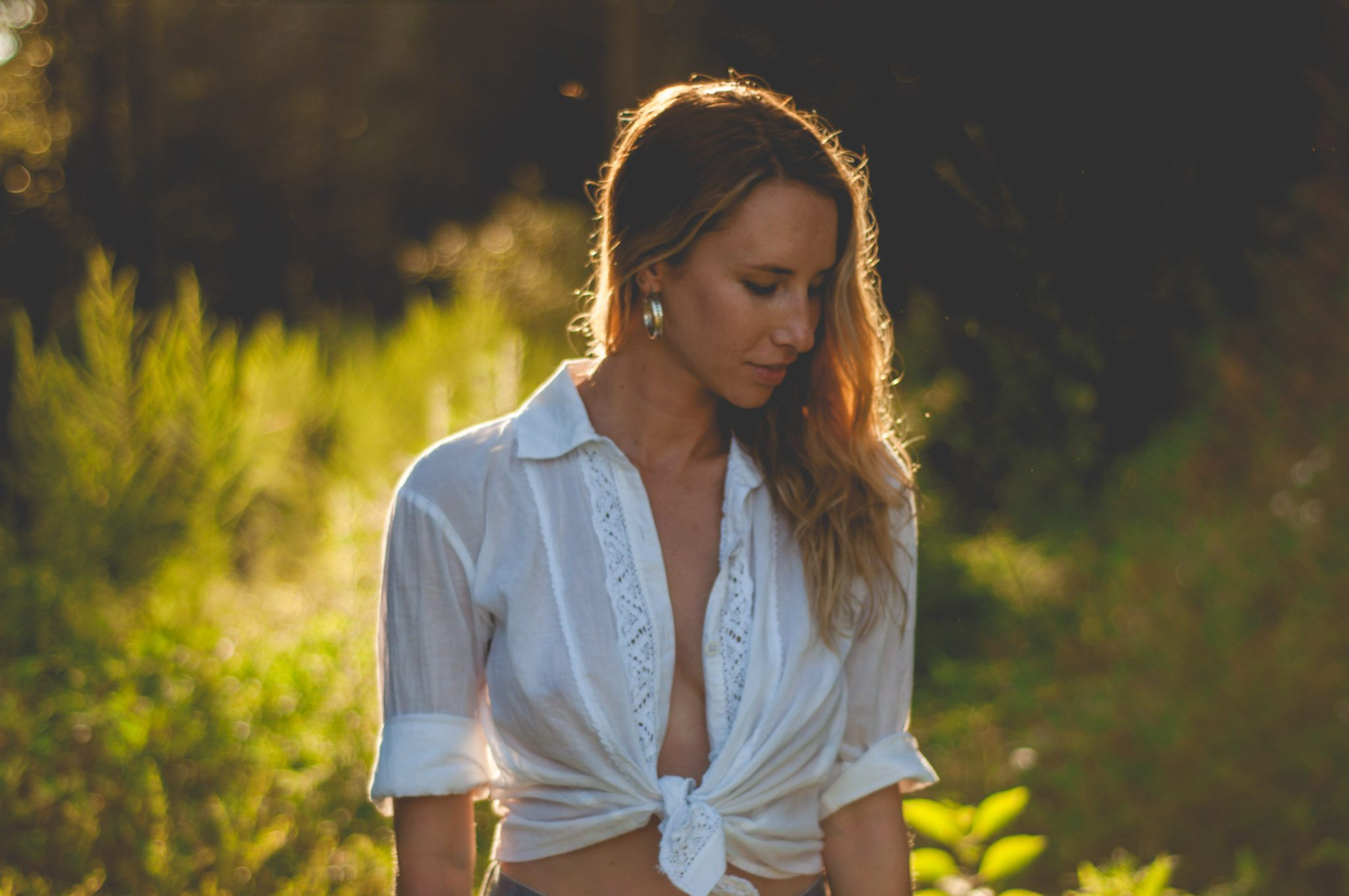 Chelsea owens in a white tied up button up in the golden light